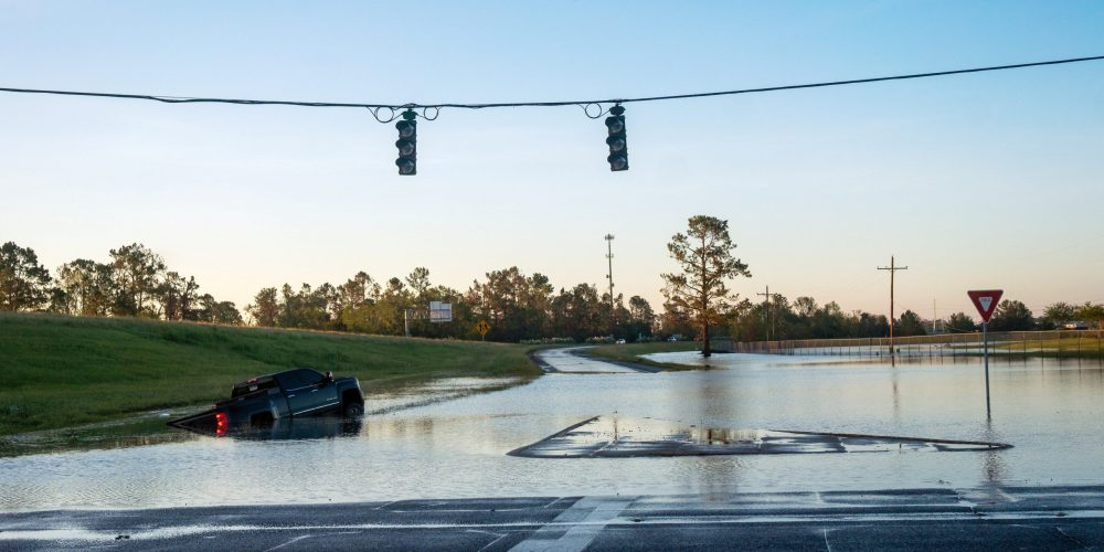 A submerged car in Lake Charles, La., is pictured on a flooded street Oct. 10, 2020, after Hurricane Delta swept through the area. (CNS photo/Kathleen Flynn, Reuters)