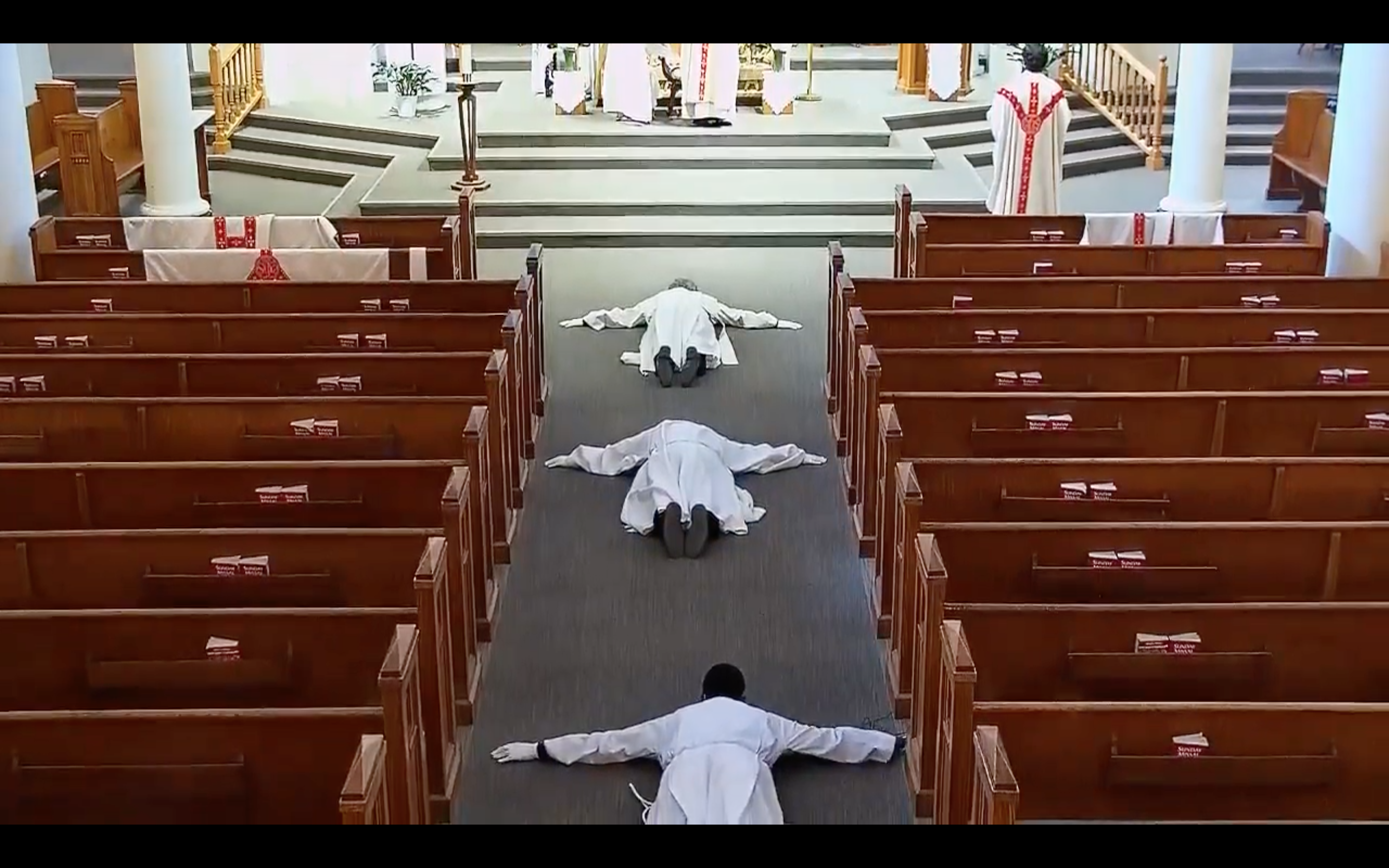 In an almost empty church, the ordinands prostrated on the ground while the Litany of the Saints was sung